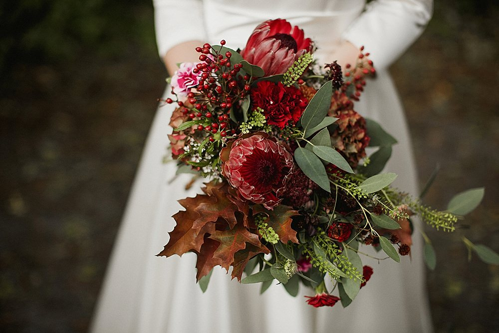 Bouquet Flowers Bride Bridal Red Burgundy Protea Greenery Foliage Abbeydale Picture House Wedding We Are Da Silva