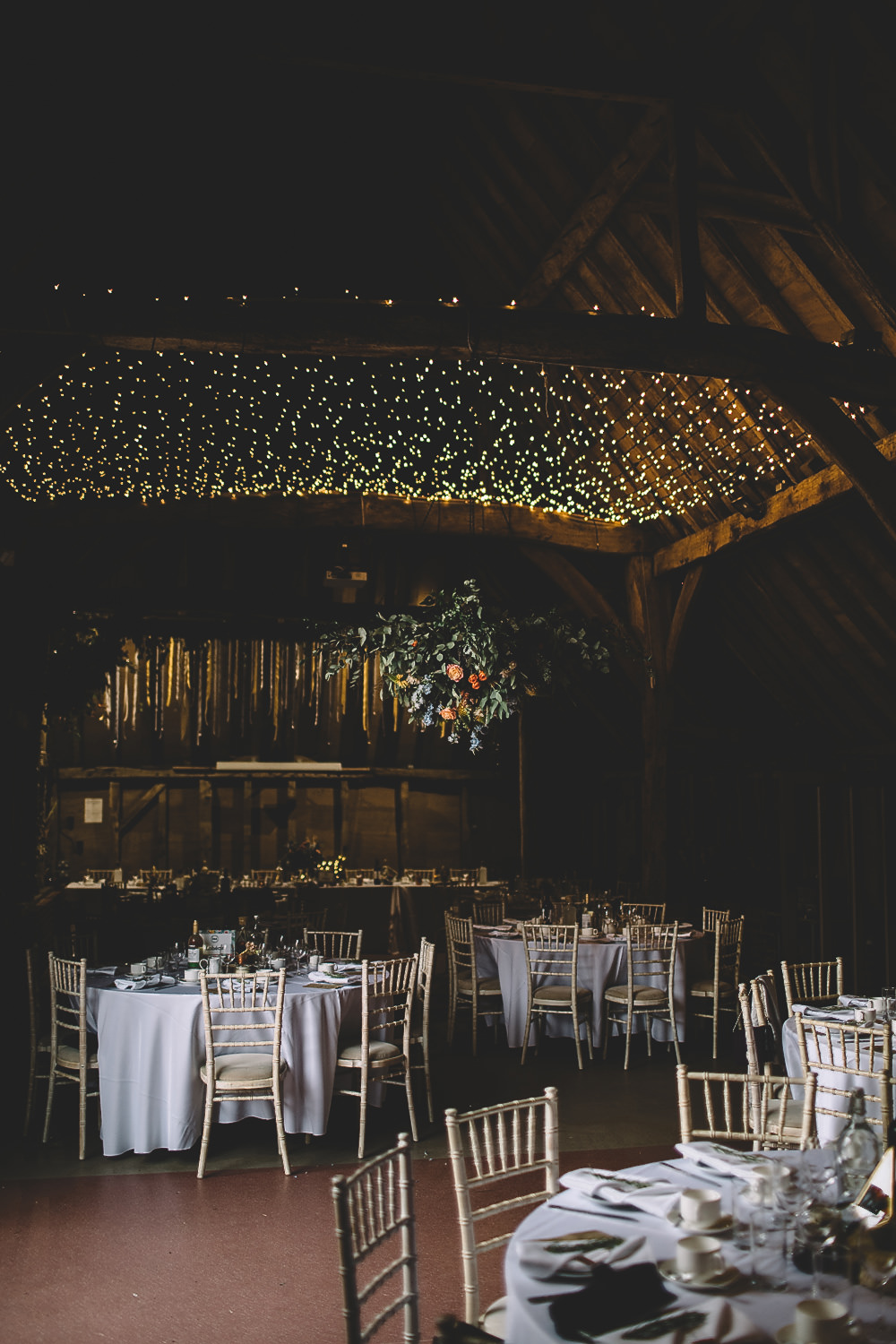 Hanging Suspended Flowers Greenery Rose Orange Coral Decor Fairy Light Canopy Gilbert Whites House Barn Wedding Carrie Lavers Photography