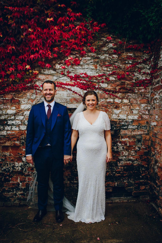 Bride Bridal V Neck Sleeves Beaded Detail Dress Gown Blue Suit Groom Veil Tatton Wedding Stock Farm Barn Amy B Photography