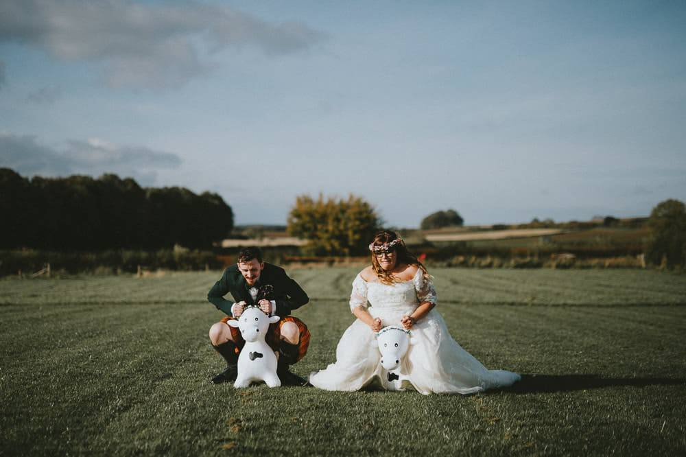 Bride Bridal Lace Sleeves Overlay A Line Dress Gown Flower Crown Kilt Green Jacket Groom Bow Tie Space Hoppers Ash Farm Barns Wedding Flawless Photography