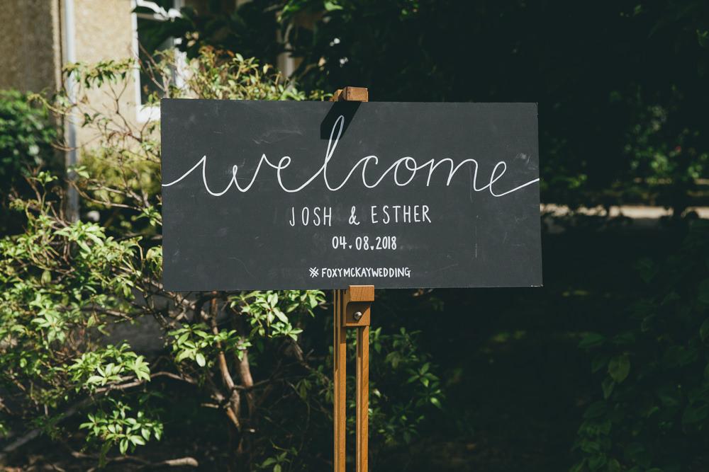 Chalk Black Board Sign Welcome Calligraphy Damerham Village Hall Wedding Lisa-Marie Halliday Photography