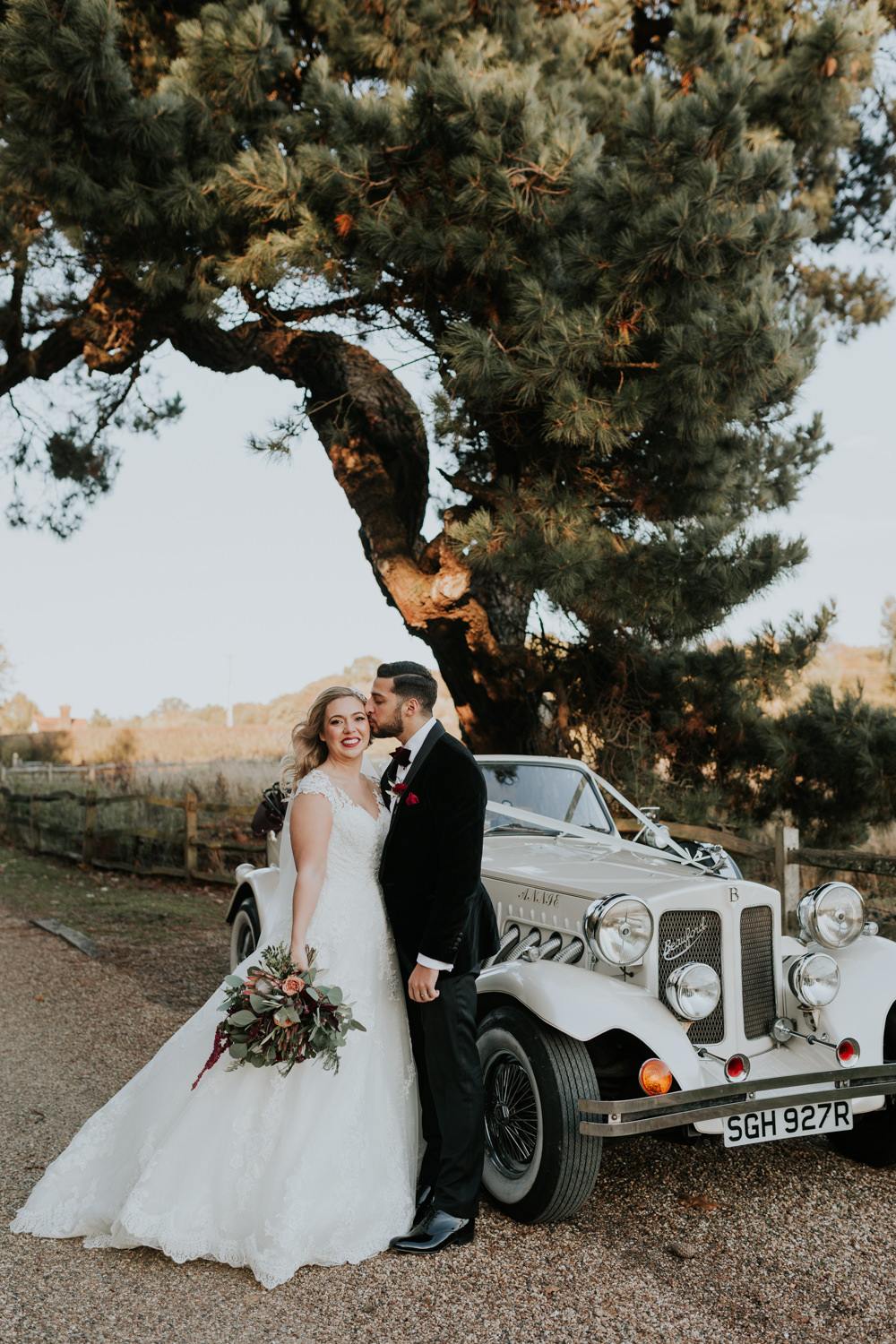 Bride Bridal Cap Sleeve Lace Overlay Dress Gown Veil Velvet Tuxedo Burgundy Bow Tie Groom Bouquet Vintage Car Transport Gaynes Park Wedding Kate Gray Photography