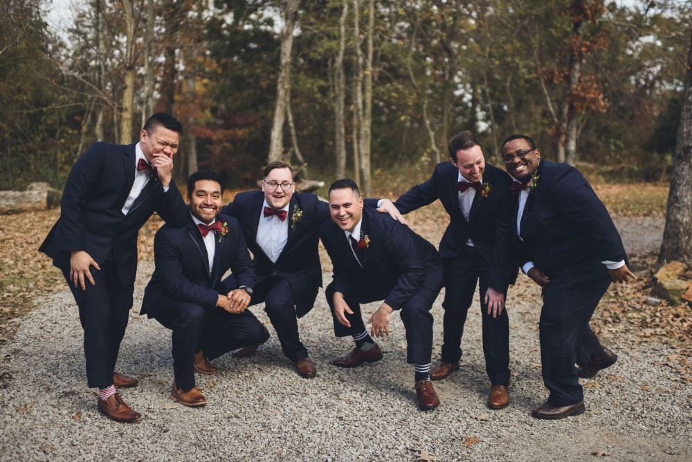 Groom Groomsmen Suit Red Bow Ties Kindred Barn Wedding The Kindred Collective