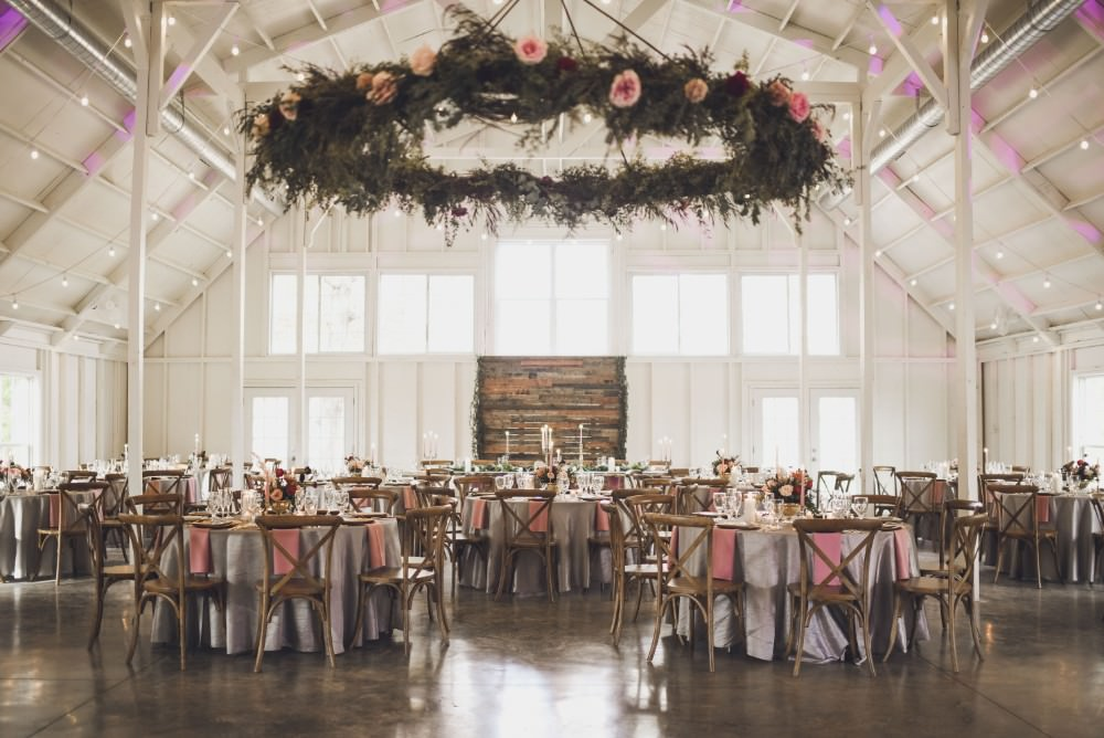 Hanging Suspended Hoop Chandelier Greenery Foliage Installation Decor Kindred Barn Wedding The Kindred Collective