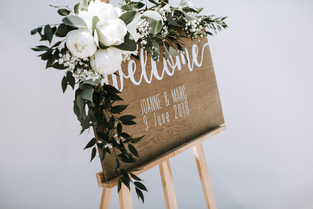 Wooden Welcome Sign Modern Calligraphy Easel Floral Flowers Portugal Destination Wedding Ana Parker Photography