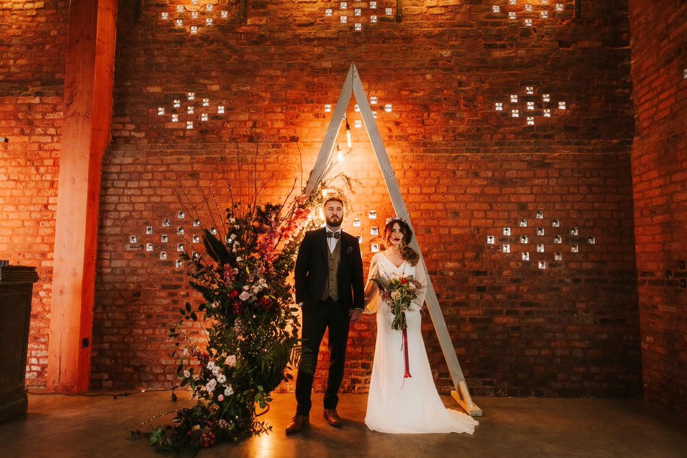 Triangle Backdrop Wooden Flower Arch Floral Installation Romantic Wedding Ideas Neon Lighting Kate McCarthy Photography