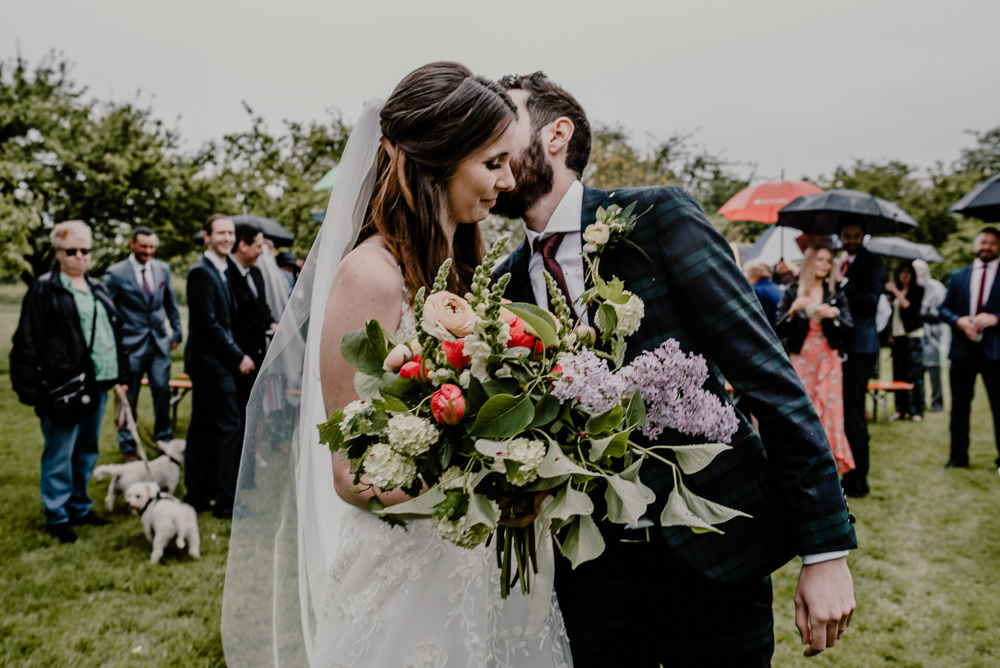 Bouquet Flowers Bride Bridal Greenery Foliage Lilac Ranunculus Rustic Barn Wedding Louise Griffin Photography
