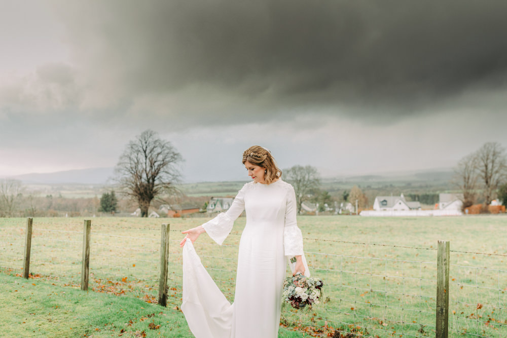 Bride Bridal Dress Gown Bell Sleeves Embellished Train Autumn Village Hall Wedding The Gibsons Photography
