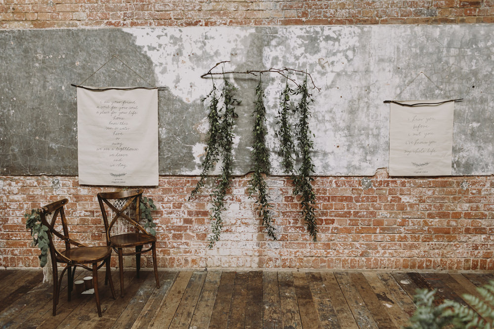Ceremony Banner Hanging Foliage Greenery Industrial Tram House Wedding Luke Hayden Photography