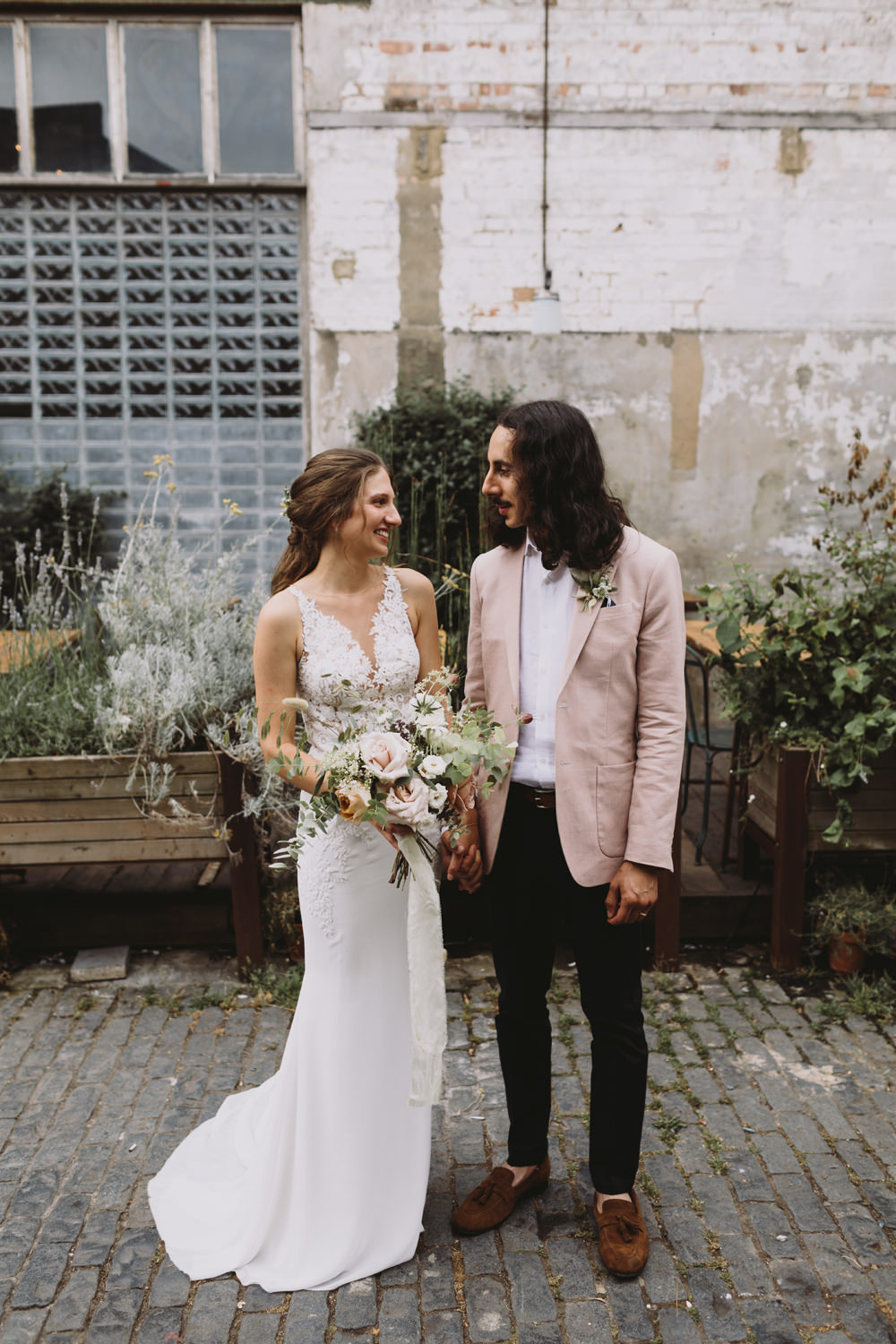 Bride Bridal Sleeveless V Neck Fit and Flare Train Pronovias Dress Gown Pink Jacket Reiss Groom Wild Bouquet Loose Handtied Rose Tram House Wedding Luke Hayden Photography