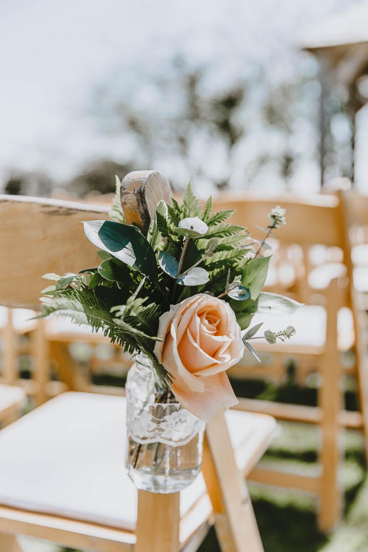 Chair Flowers Pew End Aisle Jar Lace Ribbon Blush Rose Trevenna Barns Wedding Wild Tide Creative