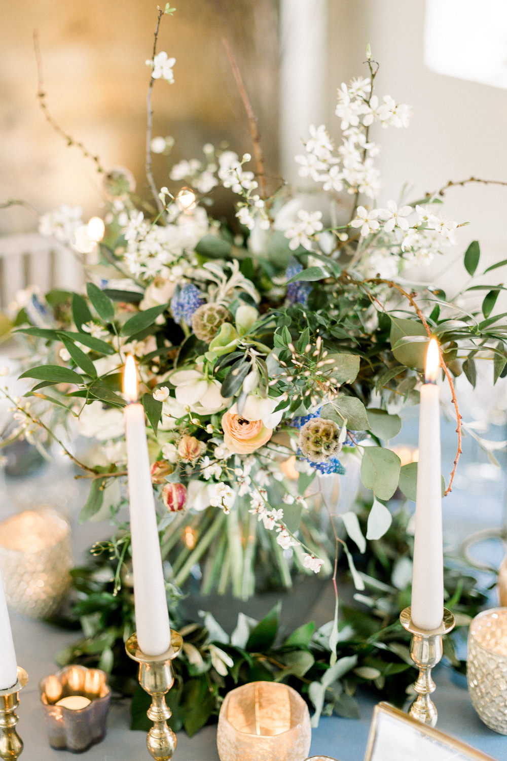Table Flowers Centrepiece Candles Grape Hyacinth Anemone Greenery Folliage Nigella Seeds Scabious Blossom Winter Blue Barn Wedding Ideas Joanna Briggs Photography