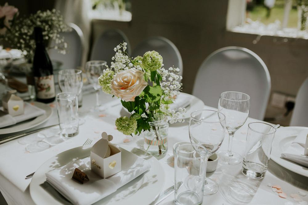 Table Flowers Pretty Centrepiece Decor DIY Village Hall Wedding PhotoBart
