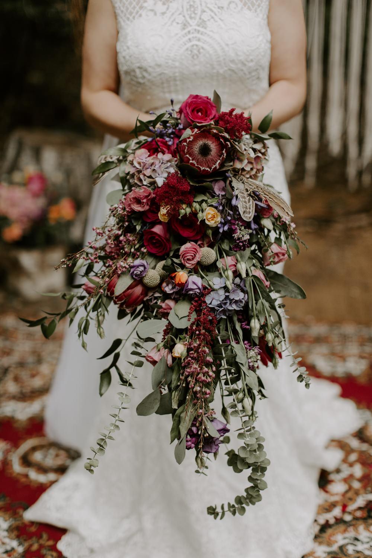 Bouquet Flowers Bride Bridal Long Trailing Cascading Protea Rose Red Foliage Greenery Dreys Wedding Grace & Mitch Photo & Film