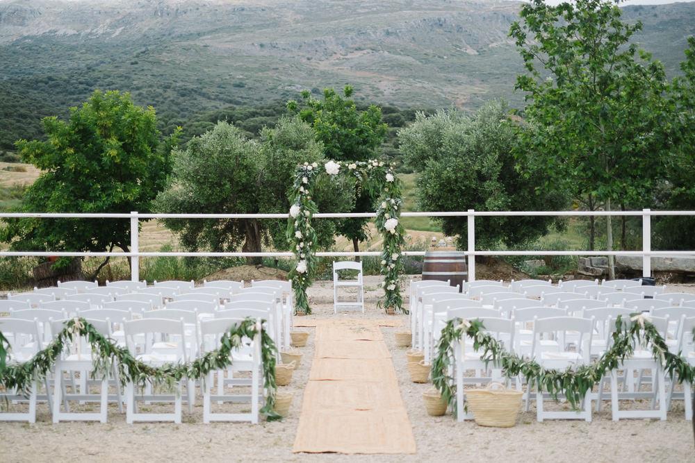 Outdoor Ceremony Aisle Foliage Arch Backdrop Flower Greenery Spain Destination Wedding Jesus Caballero Photography
