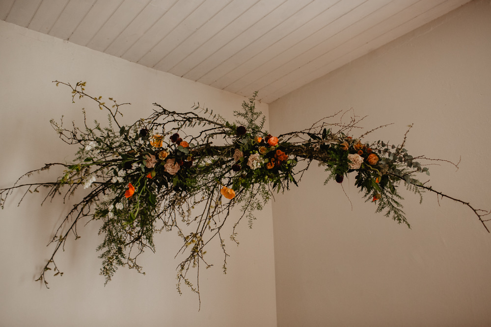 Branch Installation Flowers Wild Natural Orange Rose Autumn Fall Candles Backdrop Floral Elopement Wedding Ideas Oilvejoy Photography
