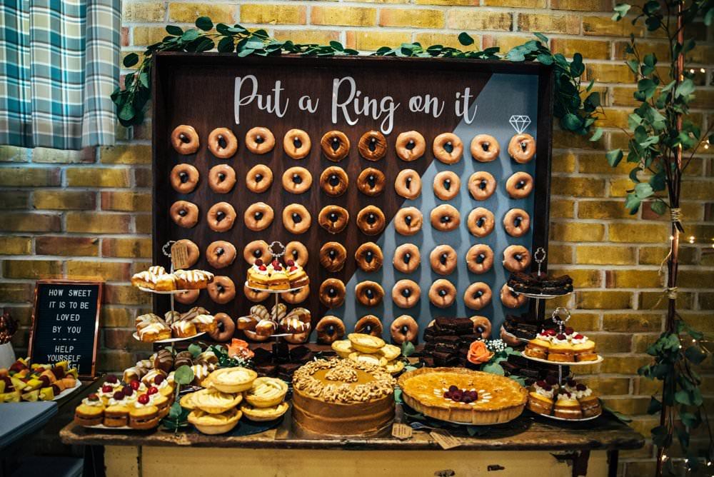 Donut Doughnut Wall Stand Cake Dessert Table Outdoor DIY Wedding Three Flowers Photography