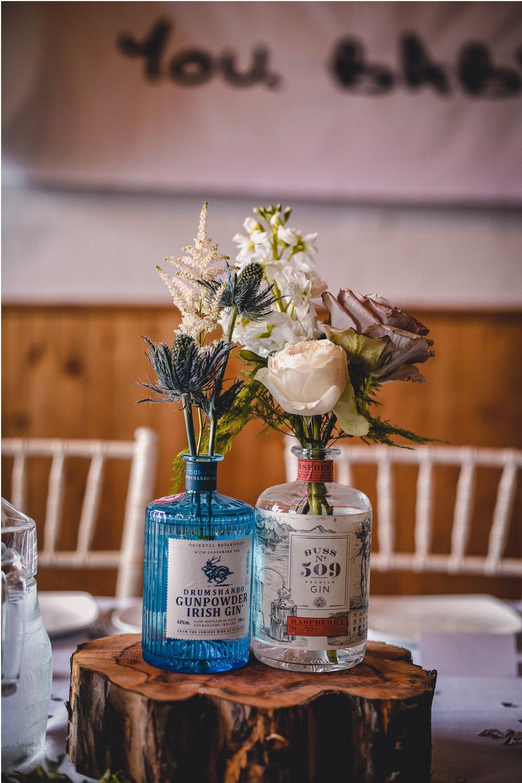 Gin Bottle Vase Flowers Floral Log Wood Slice Table Decor DIY Bohemian Wedding Love & Bloom Photography