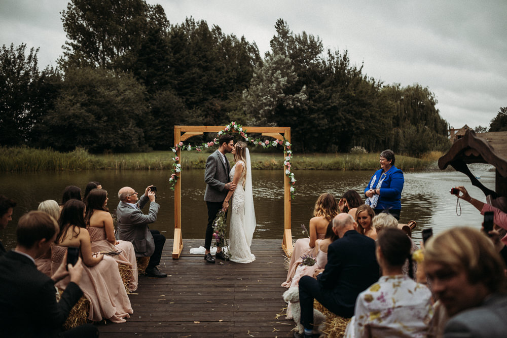 Outdoor Ceremony Wooden Frame Arch Backdrop Flowers Horsley Hale Farm Wedding Thyme Lane Photography
