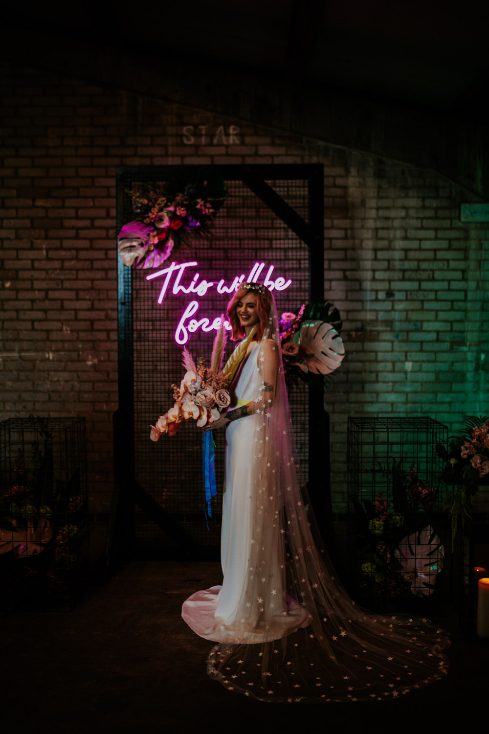 Neon Sign Wedding Ideas State Of Love and Trust Photography Backdrop Arch Flowers Dress Gown Bride Bridal Straps Train Star Celestial Veil