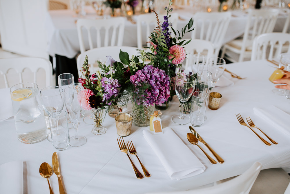 Table Flowers Centrepiece Purple Pink Hydrangea Dahlia Bottles Butley Priory Wedding Sally Rawlins Photography