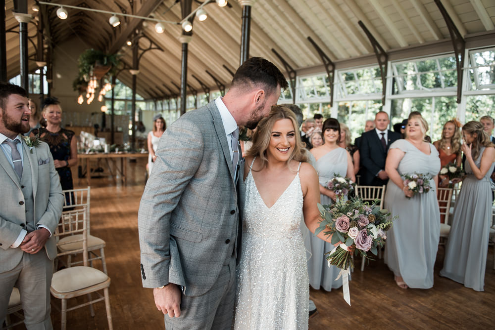 Bride Bridal Strappy Sparkly Sequin V Neck White ASOS Dress Gown Grey Checked Suit Three Piece Waistcoat Groom Hexham Winter Gardens Wedding Leighton Bainbridge Photography