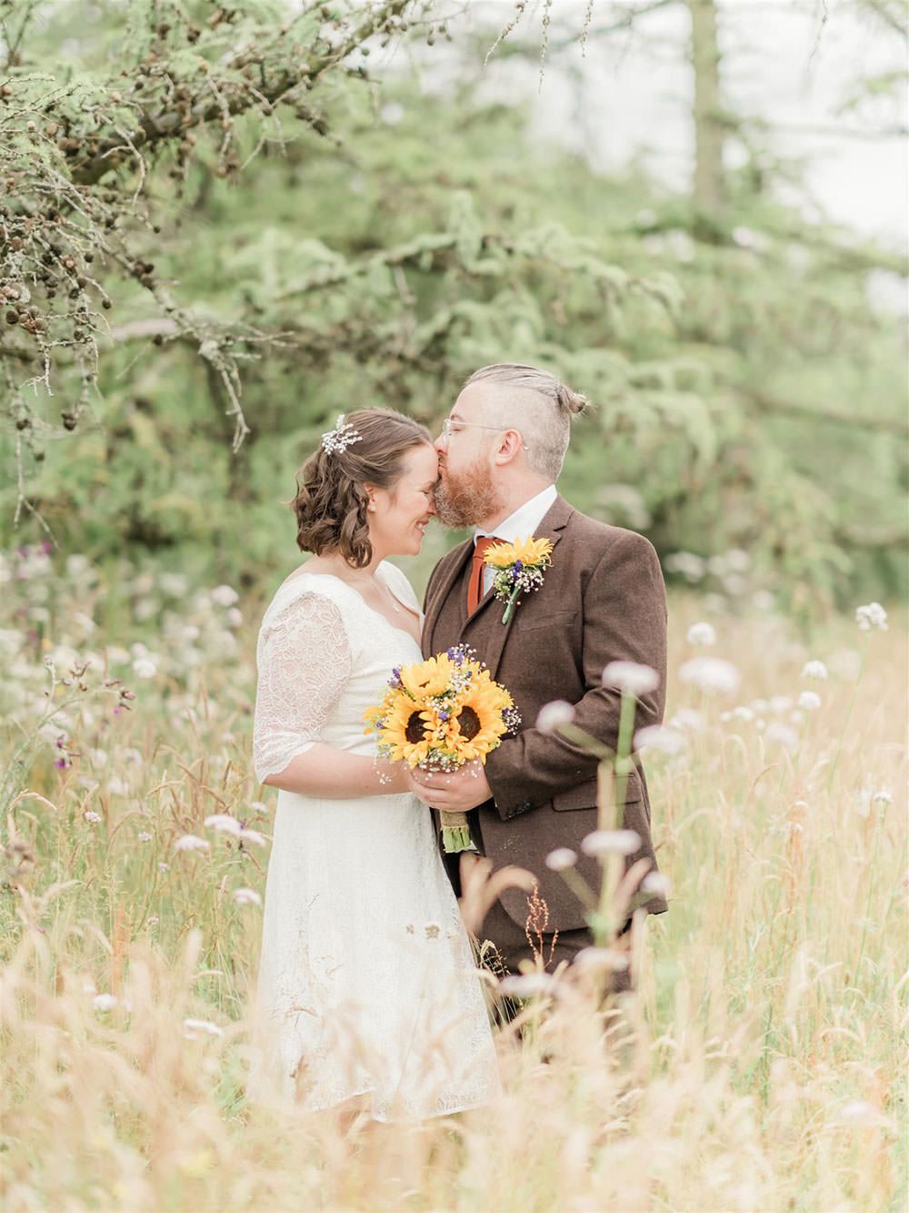 Bride Bridal Long Sleeve Tea Length Dress Lace Slaters Tweed Three Piece Suit Waistcoat Groom Sunflower Bouquet Surprise Wedding Carn Patrick Photography