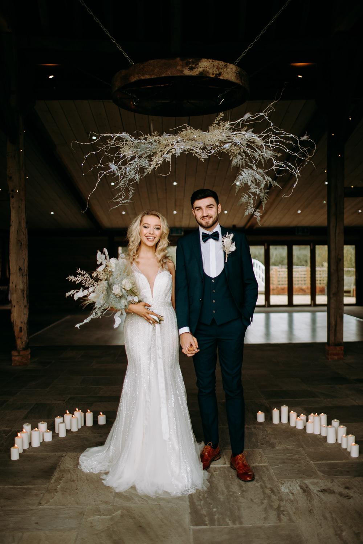 Celestial Wedding Ideas Christine Thirdwheeling Backdrop Ceremony Flower Cloud Installation Grass Foliage Candles Groom Suit Bow Tie