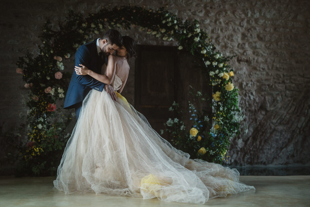 Le Marche Wedding Inspiration Francesca Angrisano Moon Gate Flower Arch Backdrop Yellow Greenery Foliage