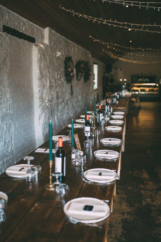 Long Wooden Tables Barn Cand;es Dalduff Farm Wedding Northern Aye Photography