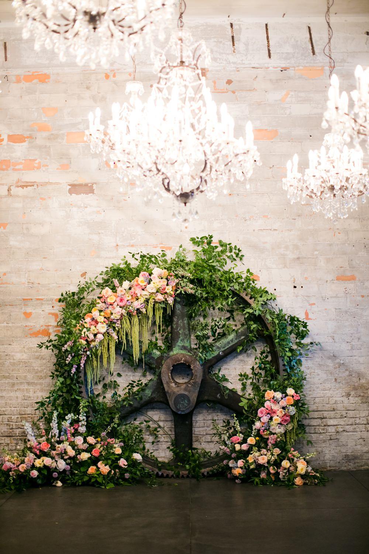 Wooden Wheel Flowers Backdrop Greenery Foliage Peony Rose Floral Minneapolis Wedding Jeannine Marie Photography