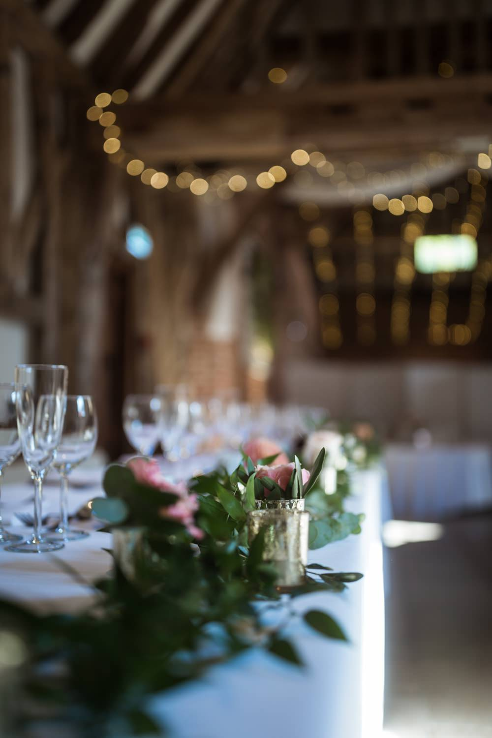 Haughley Park Barn WeddingTop Table Foliage Greenery Flowers Runner Him and Her Wedding Photography
