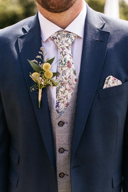 Groom Groomsmen Suit Navy Grey Waistcoat Floral Tie Buttonhole Wonwood Barton Wedding Emma Barrow Photography