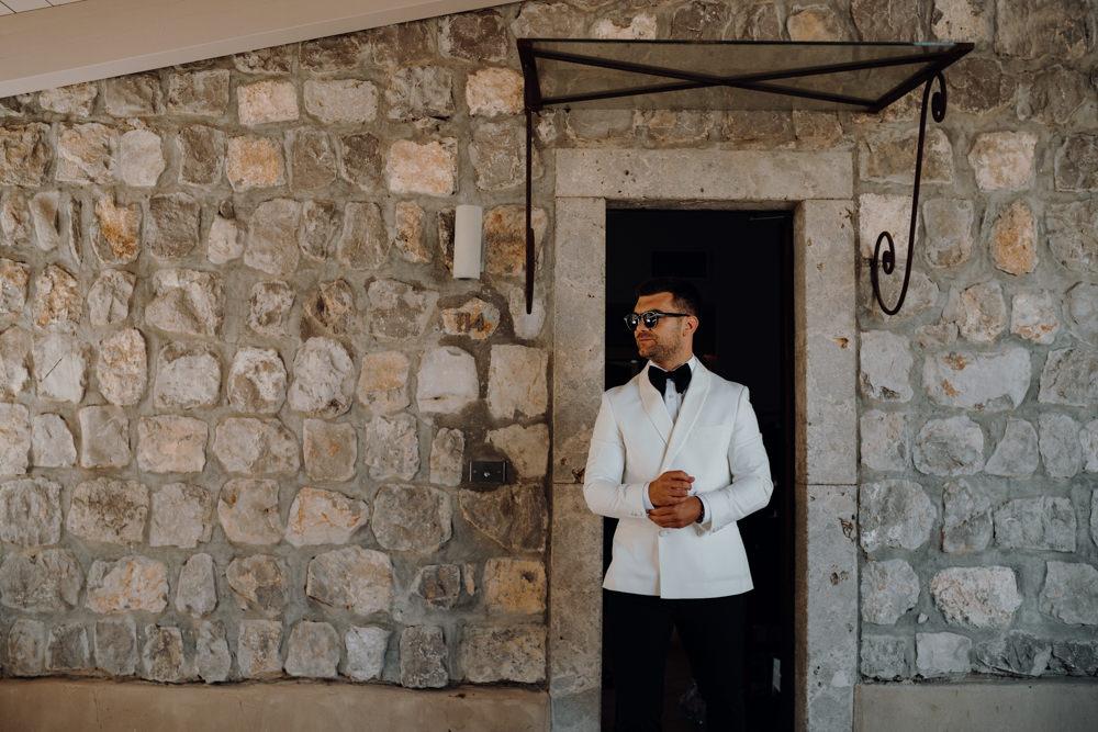 Groom Suit Bow Tie White Jacket Aquapetra Resort Spa Wedding Peter Hughes Photography