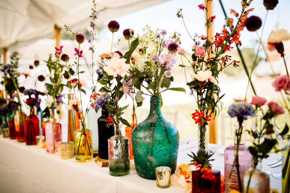 Centepiece Flowers Wild Flowers Decor Table Bottles Top Table Sperry Tent Wedding Hayley Baxter Photography