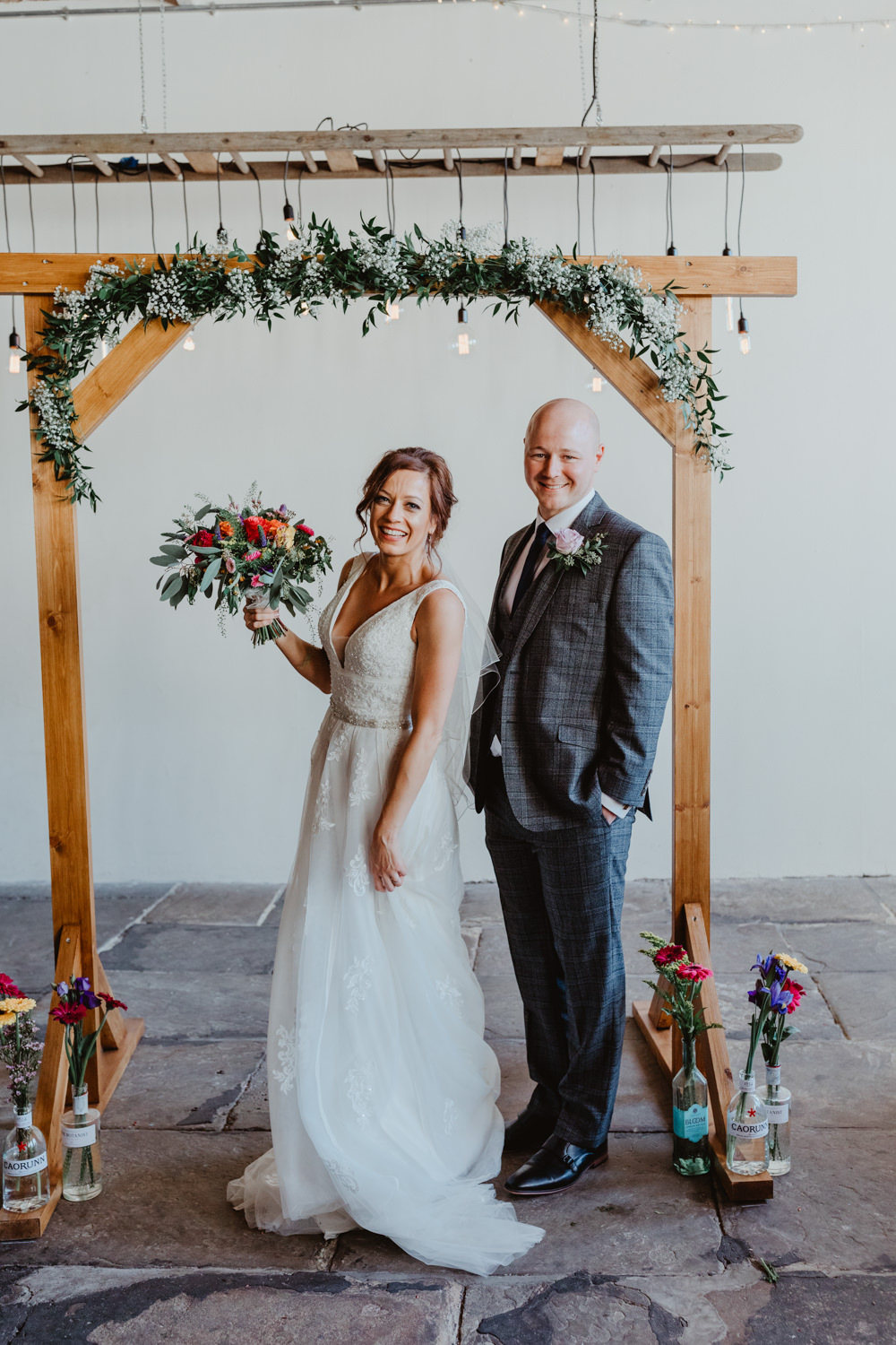 Arches Dean Clough Wedding Stevie Jay Photography Wooden Frame Backdrop Arch Greenery Foliage Festoon Lights Edison Lighting