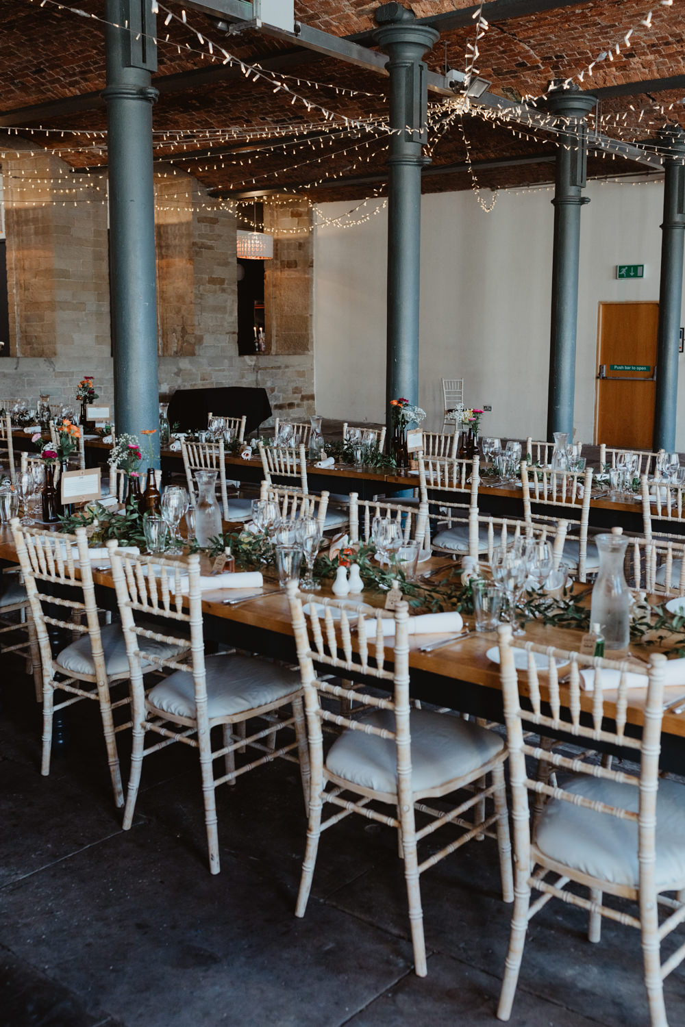 Warehouse Industrial Reception Long Tables Fairy Light Canopy Lighting Arches Dean Clough Wedding Stevie Jay Photography