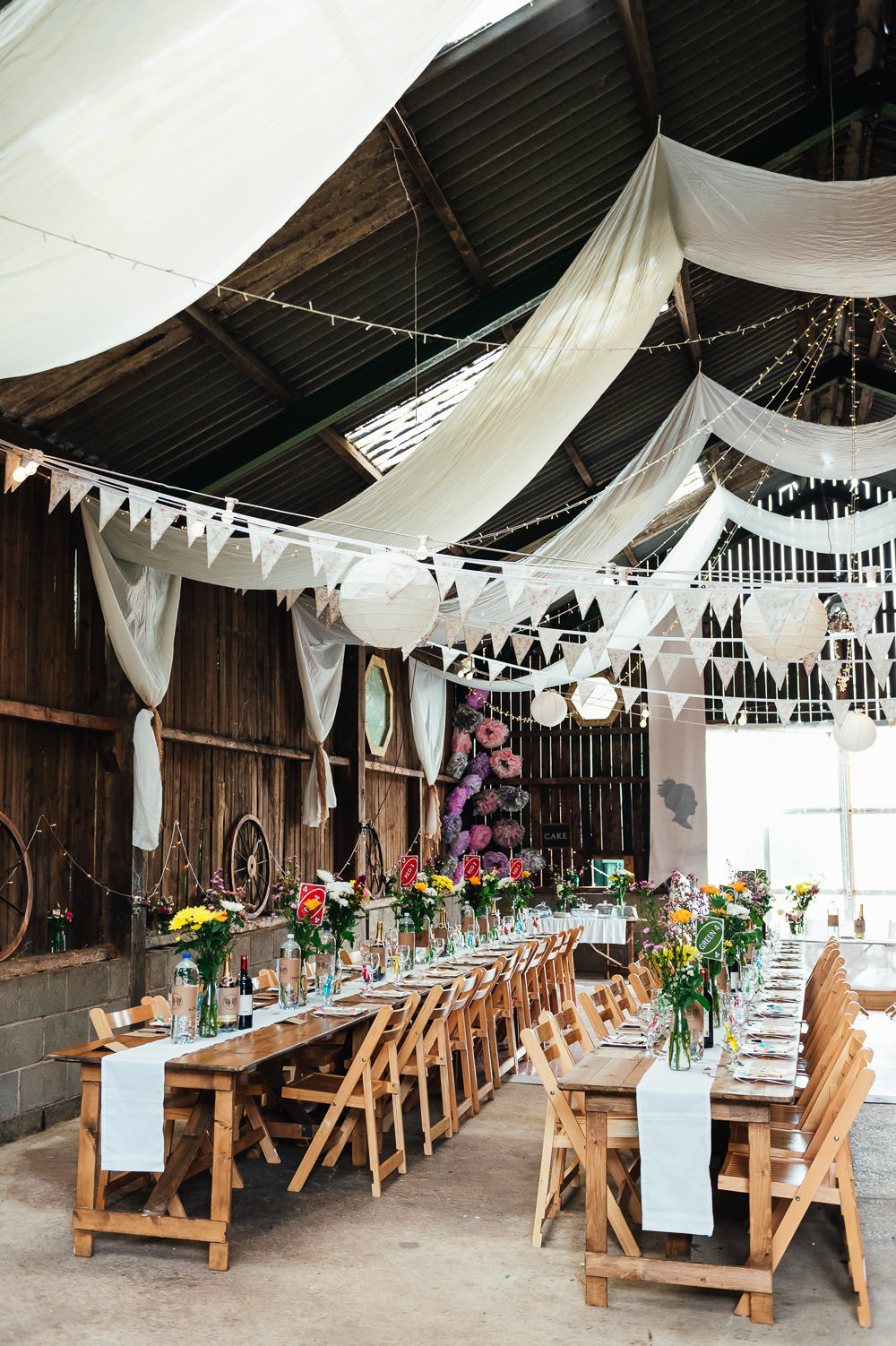 Fabric Drapes Bunting Lanterns Decor Decorations Long Trestle Tables DIY Barn Wedding Jessica Grace Photography