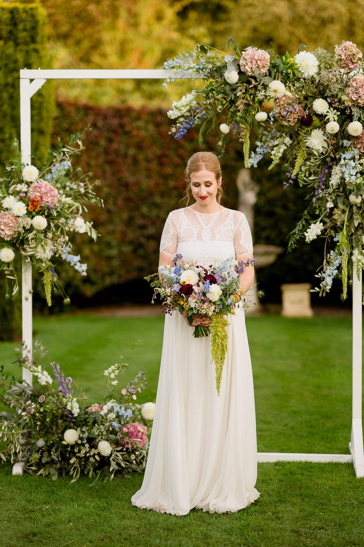 Flower Arch Floral Backrop Dress Gown Bride Bridal Sleeves Valentina Grace Loves Lace Holford Estate Wedding Voyteck Photography