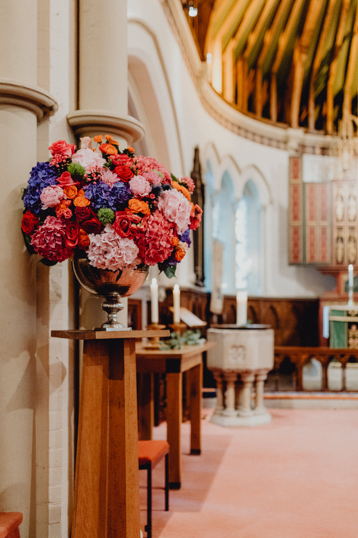 Church Flowers Arrangement Display Colourful Hydrangeas Ranunculi Peonies Intimate Pub Wedding Heather Sham Photography