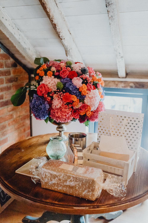 Table Centrepiece Flowers Arrangement Display Colourful Hydrangeas Ranunculi Peonies Intimate Pub Wedding Heather Sham Photography