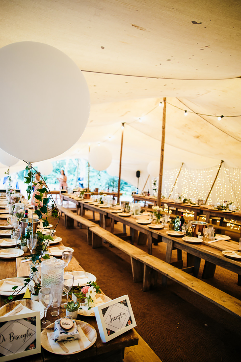 Stretch Tent Marquee Pole Long Trestle Tables Giant Balloons Decor Lila's Wood Wedding Two-D Photography