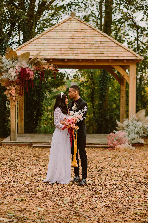 Outdoor Autumn Wedding Ruby Walker Photography Wooden Arch Gazebo Flowers Woodland Backdrop