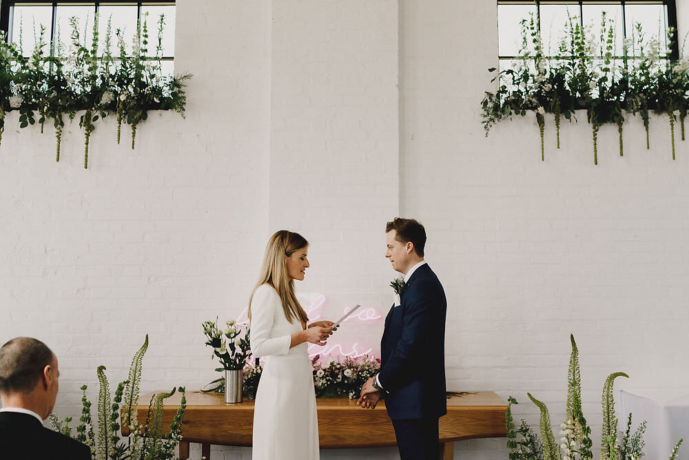 Ceremony Backdrop Greenery Foliage Neon Sign Winding House Wedding MIKI Studios