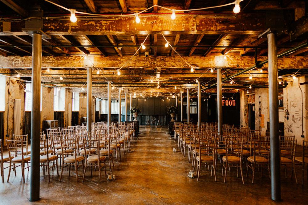 Holmes Mill Ceremony Festoon Lights Flowers Aisle Brewery Wedding Ginger Beard Weddings