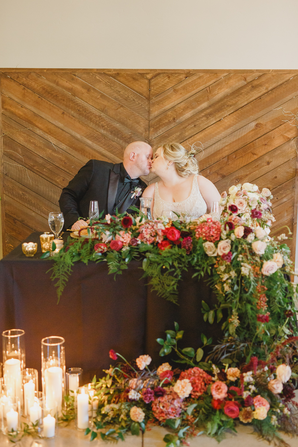 Table Decor Tablescape Flowers Black Plates Red Napkins Candles Top Table Sweetheart Enchanted Forest Wedding Kristen Booth Photography