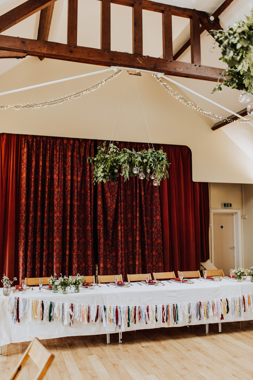 Village Hall Reception Greenery Hoops Top Table Bunting Homemade Wedding Wyldbee Photography