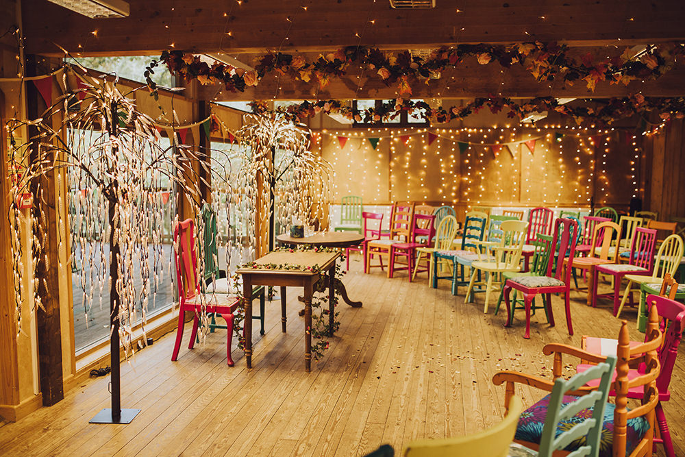 Ceremony Room Fairy Lights Colourful Chairs Treehouse Wedding Honeydew Moments