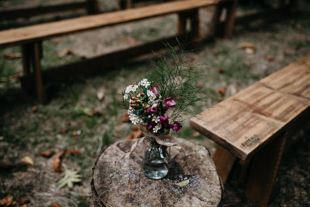 Flowers Log Stump Cotswold Woodland Glamping Wedding Elaine Williams Photography