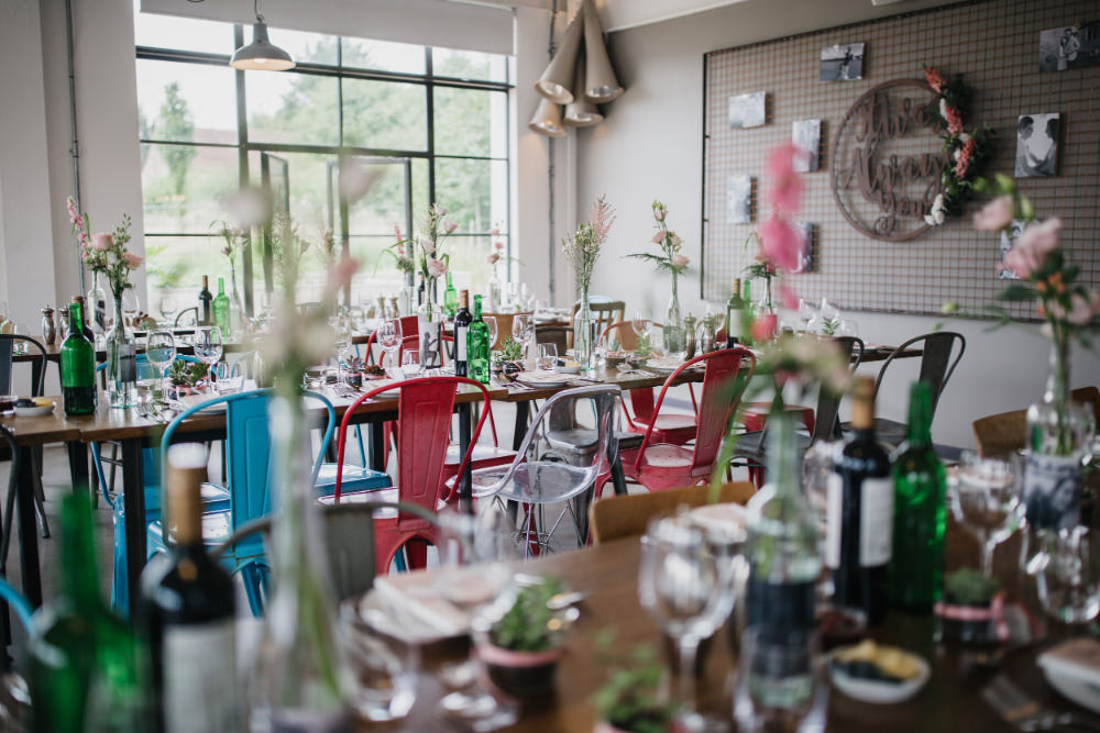 Wooden Table Bottle Flowers Pastel Decor Mismatched Industrial Chairs Field Kitchen Wedding Siobhan Amy Photography